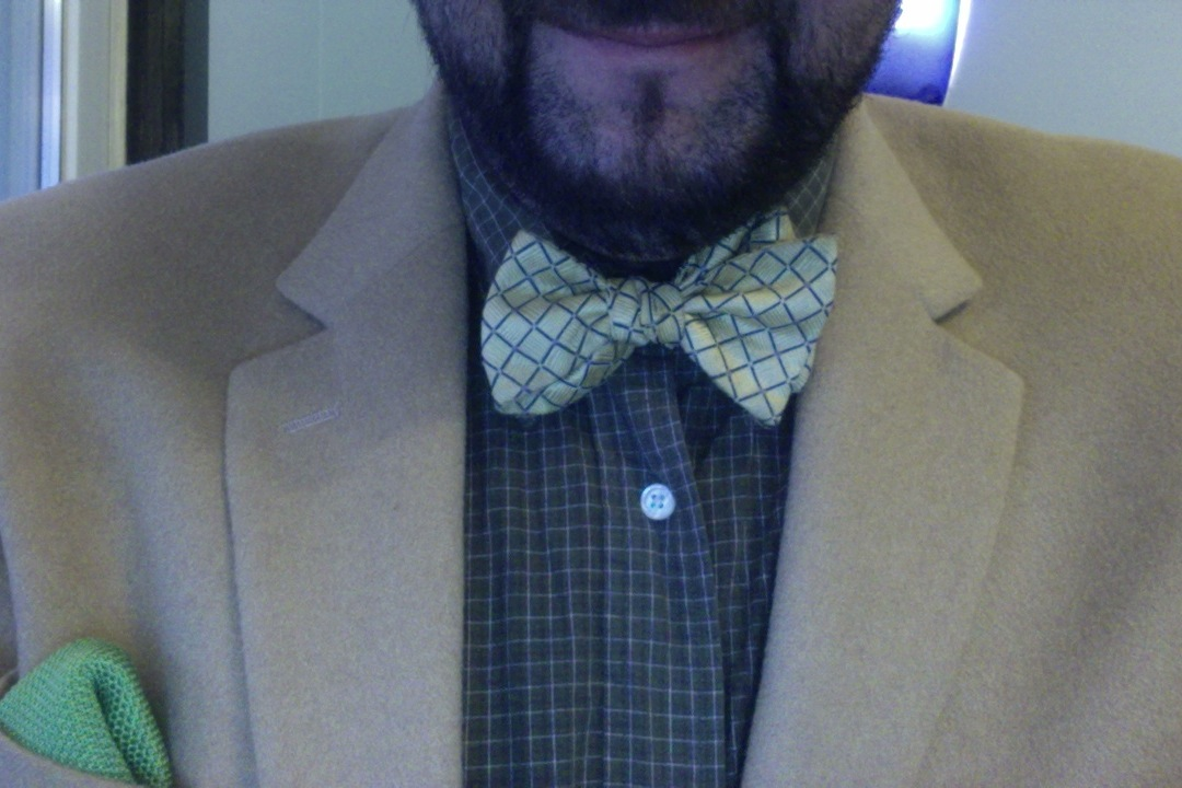 In honor of my Alma Mater. Green Shirt, Yellow Bowtie, camel coat and green square in the pocket.