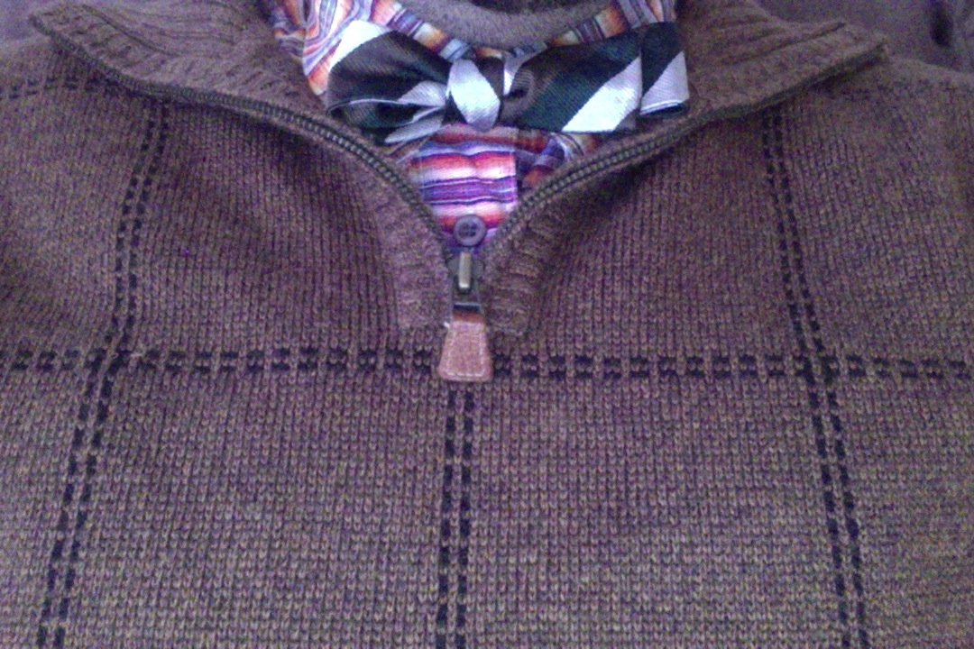 Multicolored shirt, green/silver/brown tie, brown sweater