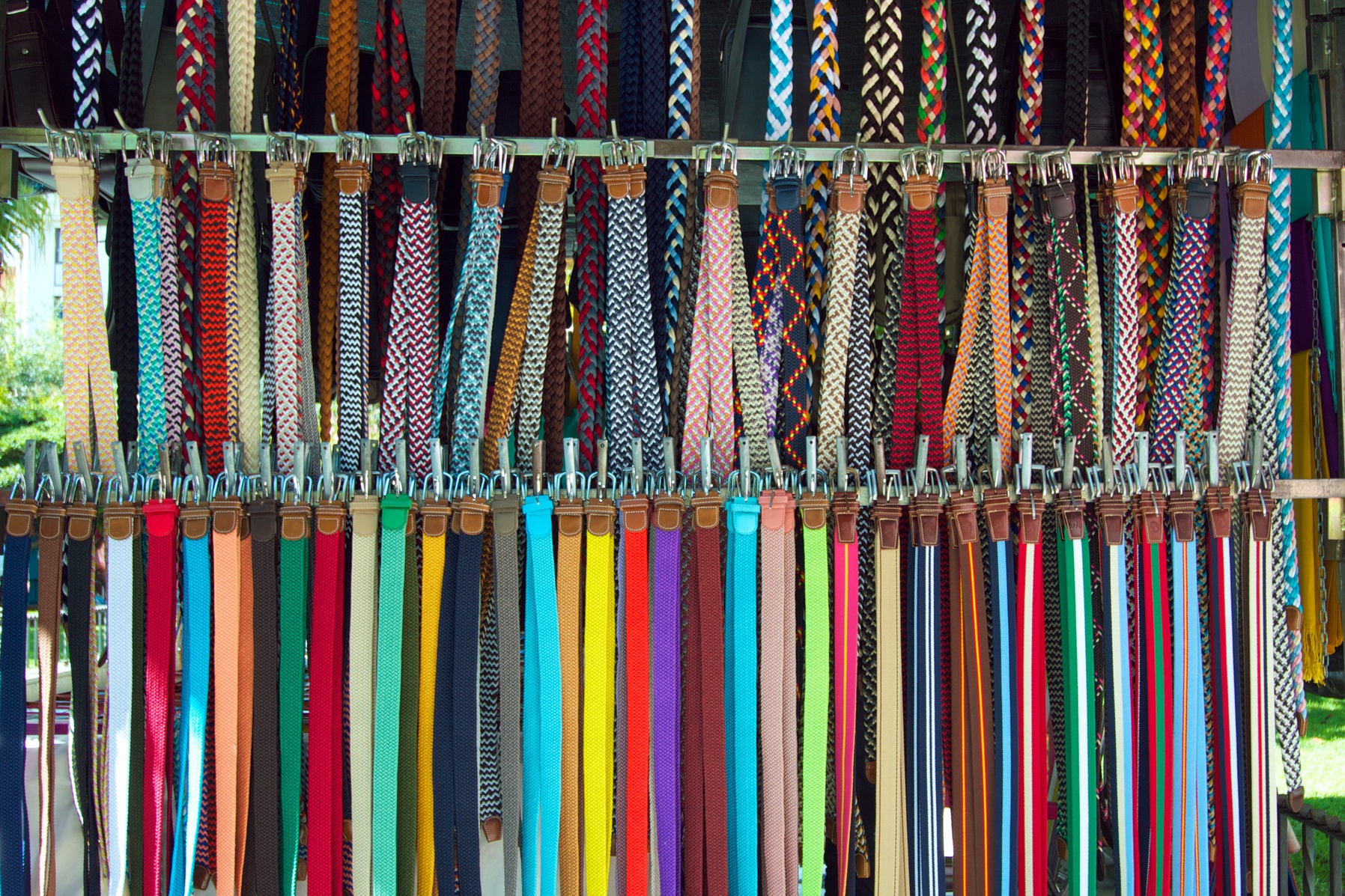 3 rows of colorful belts for sale