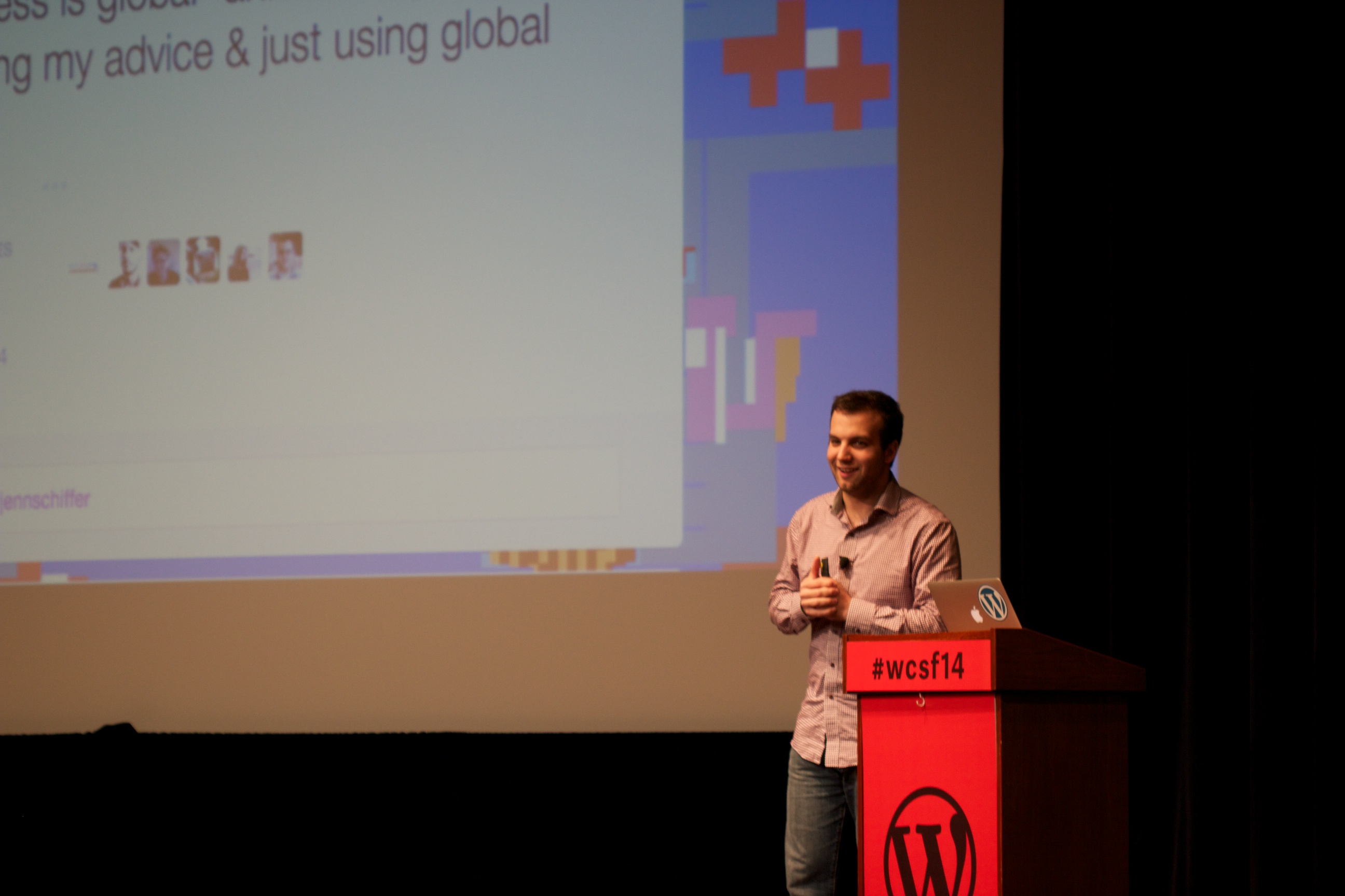 Andrew Nacin on stage giving a presentation.