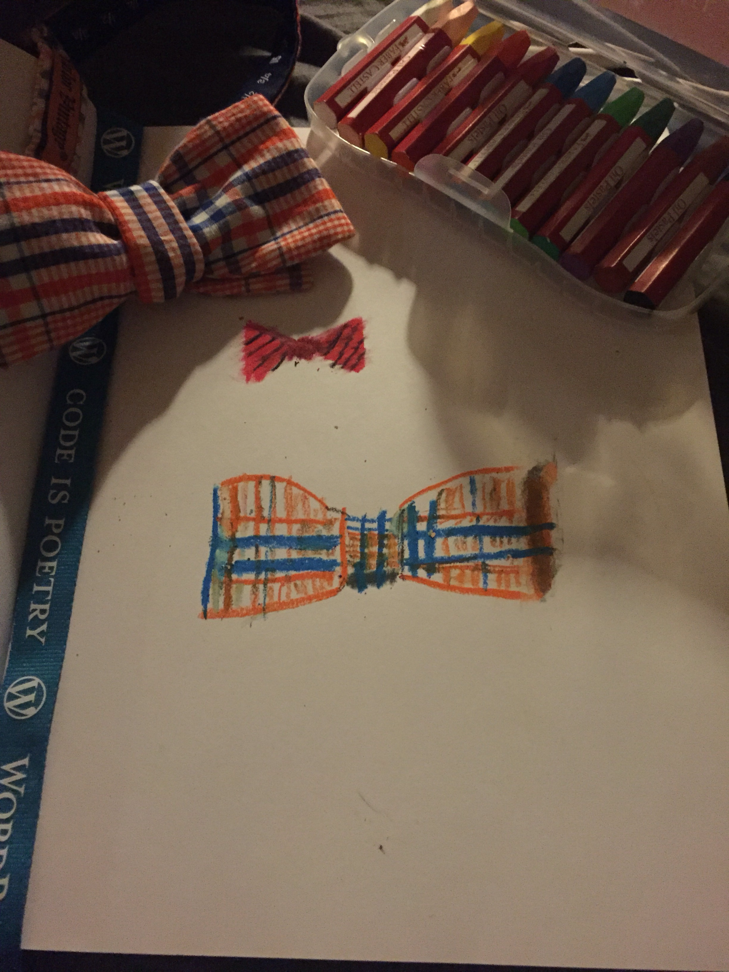 pastel drawing of an orange and blue bow tie