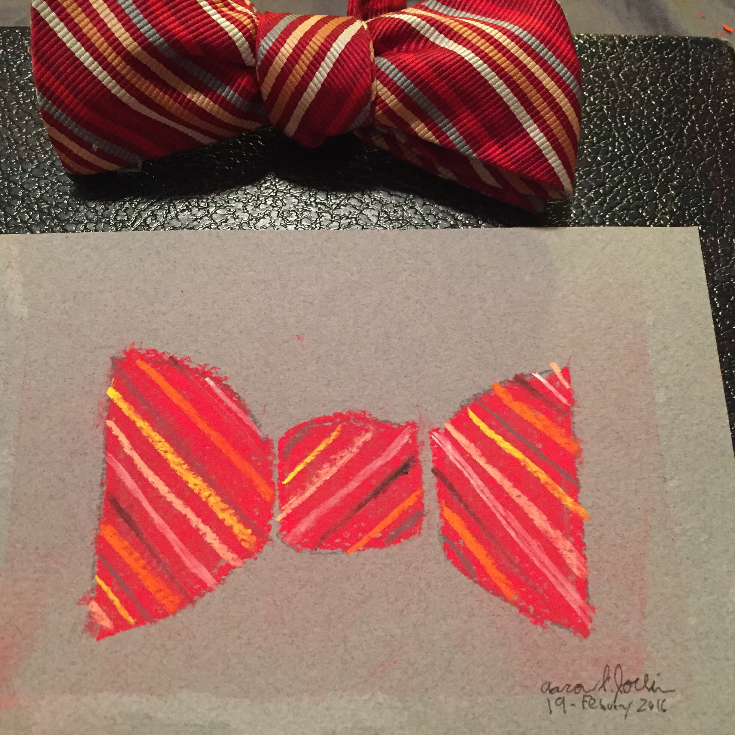 pastel drawing of a red with multi-color stripes bow tie