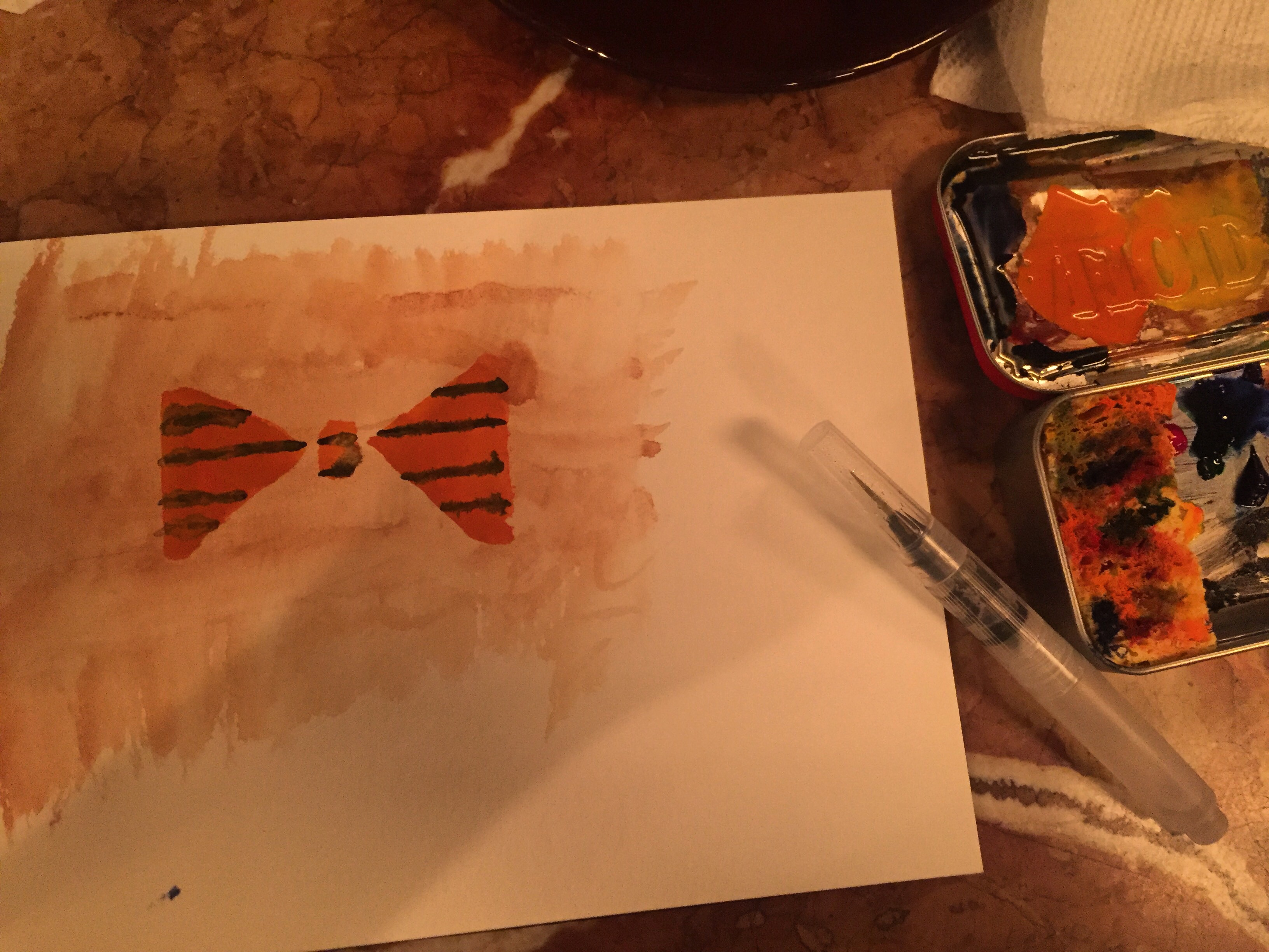 Orange with blue stripe bowtie and a woodlike background on watercolor