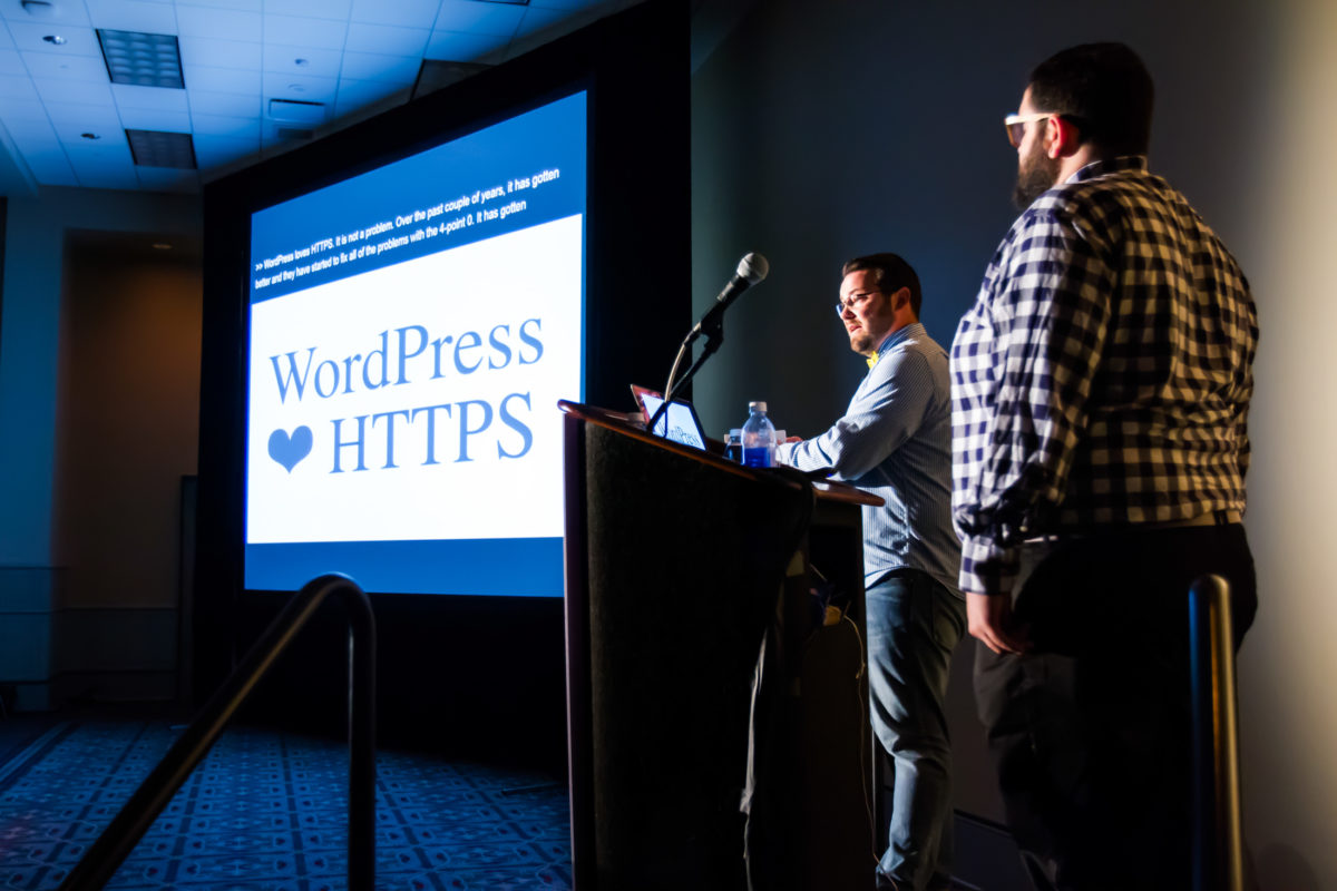 Aaron Jorbin and Zack Tollman on stage at WordCamp US 2015.